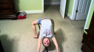 Gymnast Lili shows how to do a gynastic move, a Fish Roll