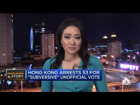 Dozens of Hong Kong democracy activists arrested for allegedly breaching national security law