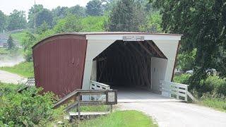 Driving Through One Of The Bridges Of Madison County -- Cedar Bridge