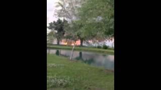 Two men setting a field on fire