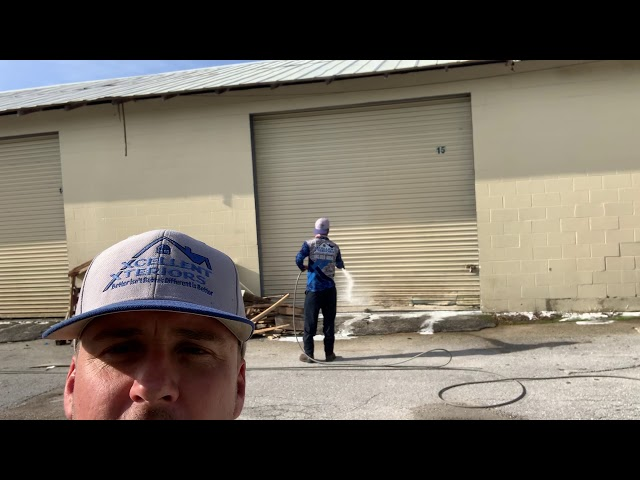 Pressure Washing a storage unit in Lakeland, Florida.