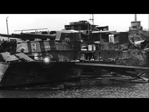 Damaged battleships at the harbor in Toulon, France HD Stock Footage