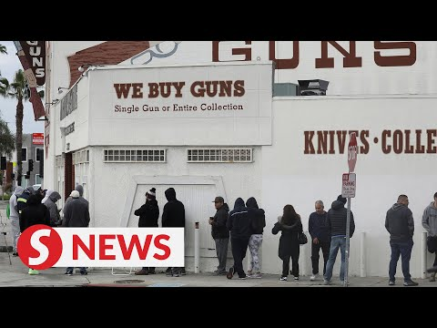 Huge queues as Americans buy guns and ammo amid Covid-19 outbreak