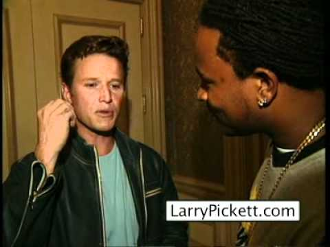 Billy Bush and Larry Pickett exchange pointers while preparing for their celebrity interviews.