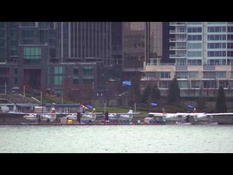 Five water planes docked in Vancouver harbor