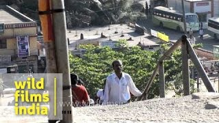 Visitors climb the Chandragiri hill - Karnataka