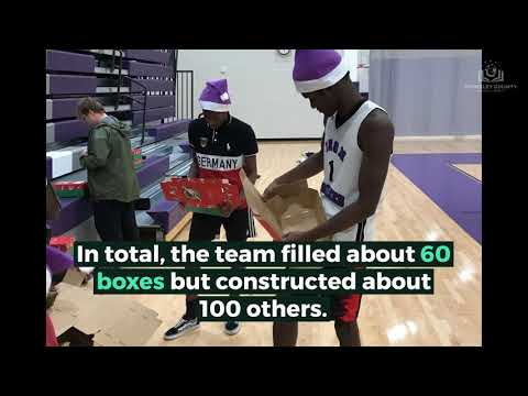 PSH basketball players pack boxes for Operation Christmas Child