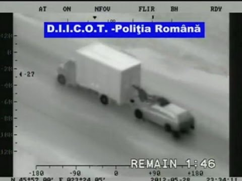 Romanian gang attempt truck robbery from bonnet of moving car