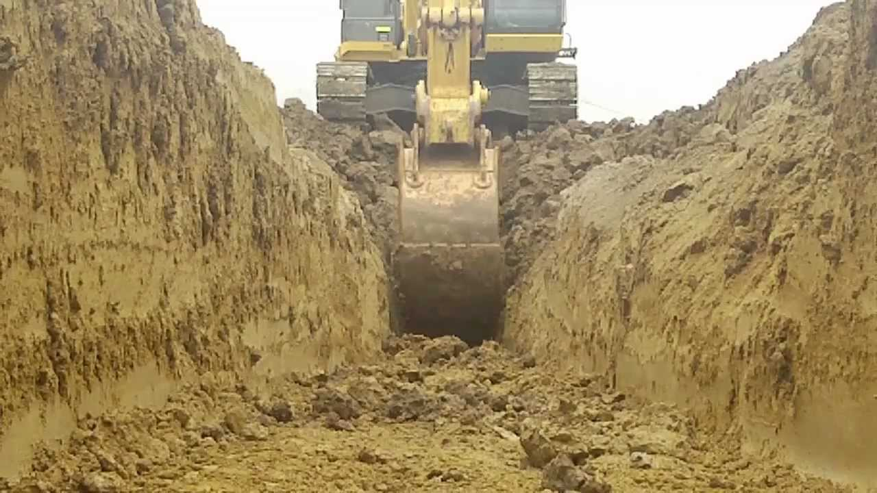 Worms Eye View Of A 35ton Excavator Trenching And Benching