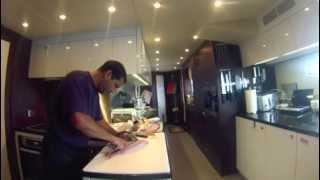 Super Yacht Chef Carlos Concha butchering fresh local fish in Florida