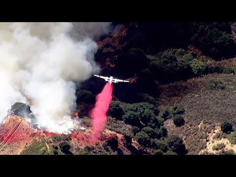 RAW: CalFire Planes Drop Fire Retardant On Oakland Hills Fire