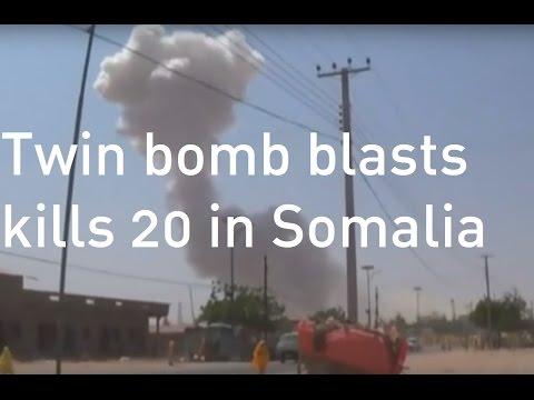 Twin bomb blasts kill as many as 20 people in Somalia