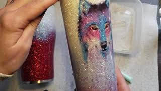 Applying a waterslide decal on a 30 ounce modern curve glitter tumbler