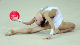 Rhythmic gymnastics. Performance with ball(Portfolio on Fotolia: https://us.fotolia.com/p/205425480 Portfolio on Shutterstock: https://goo.gl/2rTnIQ., 2015-05-27T11:22:57.000Z)