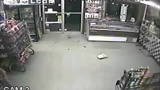 Robbery FAIL robber slips on wet floor