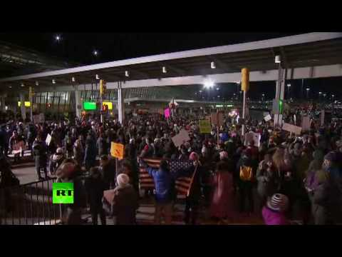 'Let them in!': Protesters rally at JFK against Trump's refugee ban