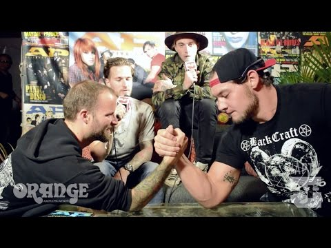 Highly Suspect arm-wrestle WWE NXT's Baron Corbin