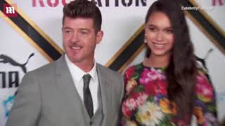 Robin Thicke & April Love Geary attend Roc Nation Brunch