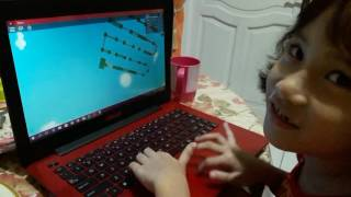 Six years old girl playing roblox