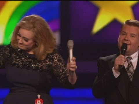 Adele gives the middle finger after being cut off by James Corden at The Brits