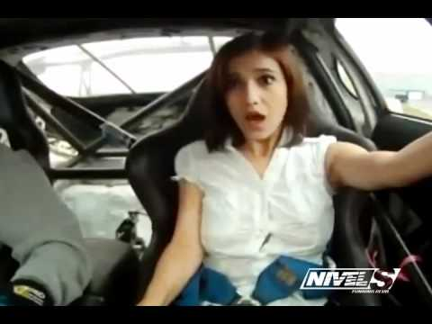 Girl Pops Out Of Shirt In Race Car