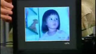 Call For Help - James Kim shows off Digital Photo Frames