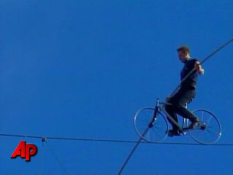 Raw Video: Record Breaking High Wire Act
