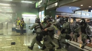 Hong Kong police fires tear gas at protesters in metro station