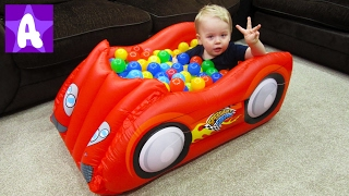 Alex playing and having fun with Car BALL PIT and balls