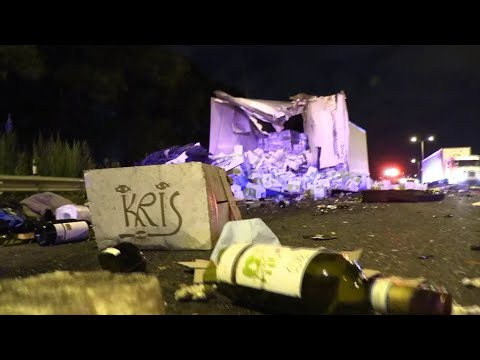 Mick Lee - Truck Spills Hundreds of Bottles of Wine Onto the Bishop Ford in Chicago