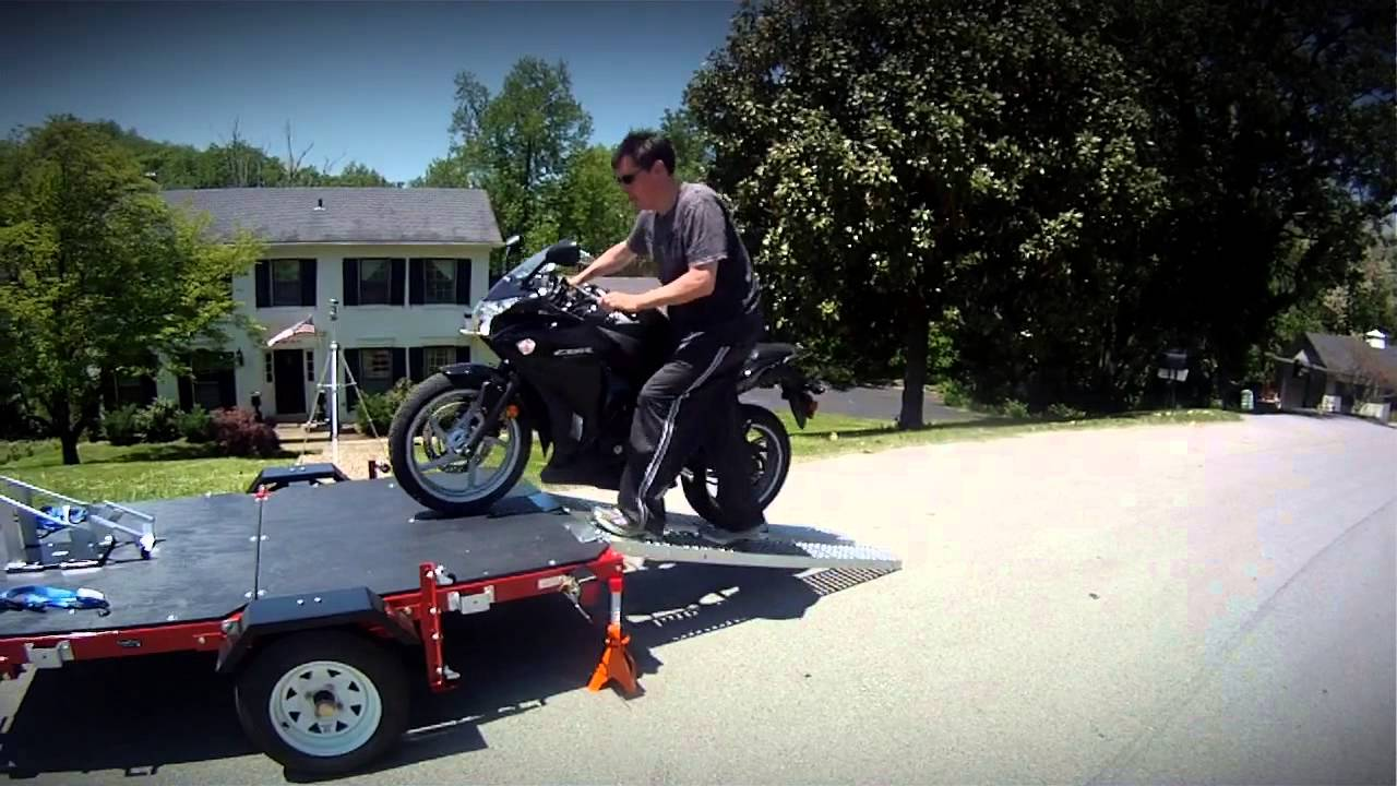 How To Load A Motorcycle On A Trailer With Ramps Youtube