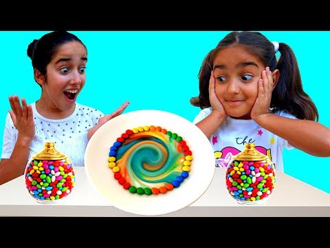 Esma and Asya incredible experiment with colorful candies fun kid video