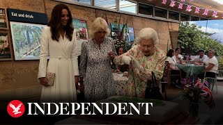 Queen uses ceremonial sword to cut cake during Eden Project engagement