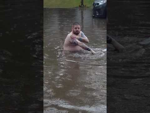 Man Takes a Bath in the Flooded Streets of Saskatoon