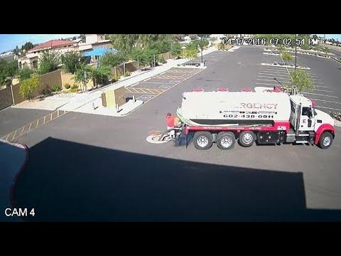 RAW VIDEO: Ex-truck driver dumps sewage in storm drain at Phoenix school