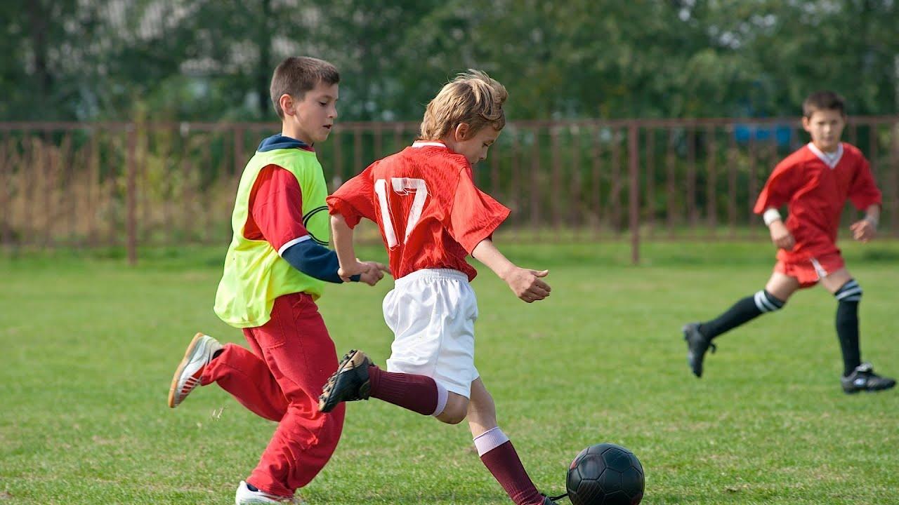 Boy Kicking Soccer Ball
