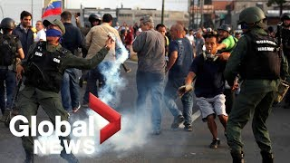 Tear gas fired at Venezuela's Guaido as supporters join uprising against Maduro