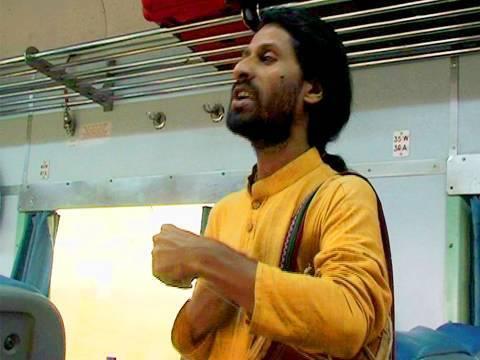 Baul Singer in a train, Kolkata