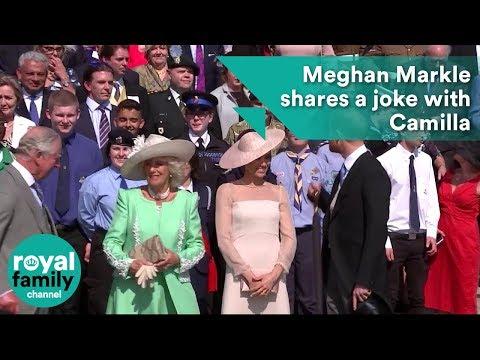 Meghan shares a joke with Camilla at Prince Charles 70th birthday at Buckingham Palace