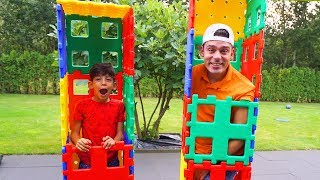 Jason and Alex play together with Toys
