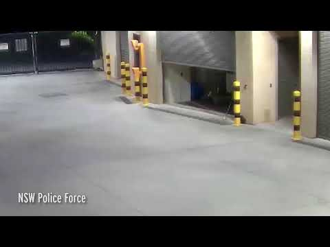 Police share eerie clip of an unused garage door opening by itself before a broom mysteriously FLIES
