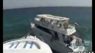 Two Tourist Boats Collide at High Speeds