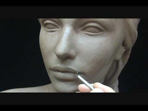 Sculpting a female head in clay. Sculpting tutorial and demo.