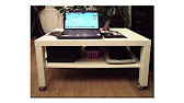 Например, его можно использовать вместо прикроватной тумбочки для размещения ноутбука. Можно купить столик на колесиках оригинальной формы.