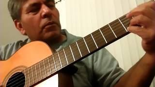 A tocar Guitarra Por Primera Vez