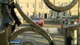 Car Drives down Dail Eireann steps
