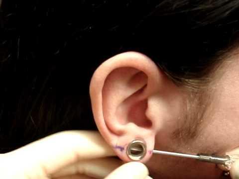Piercing Transverse Lobe Through Flesh Tunnel
