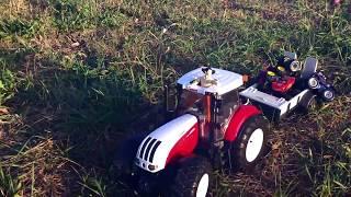 BRUDER Трактор. Игрушки для детей. Открываем коробку и играем. Спецтехника, tractor. BRUDER Toy(Ура! У нас новая игрушка - трактор от Bruder! Трактор просто замечательный. У трактора сверху вставляется руль..., 2015-11-07T06:00:00.000Z)