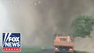 Raw video: Tornado rages past motorists in Germany
