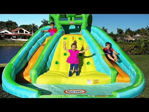 Diana and Roma pretend play with Inflatable water slide